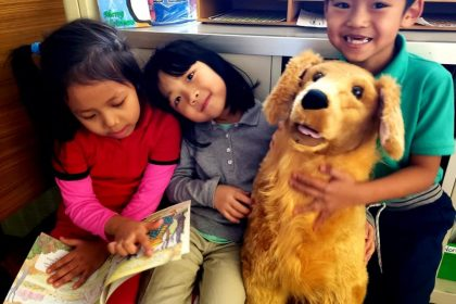First graders reading to a stuffed dog