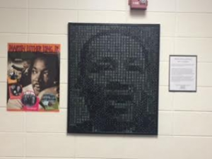 MLK Portrait framed hanging in hall