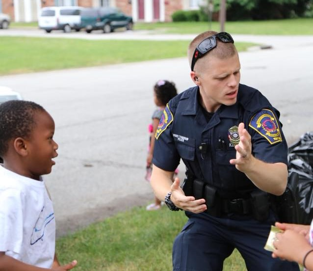 Officer Klein Dancing with Child