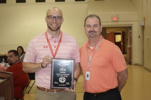 Brian Knight receives 2019 District Administrator Award from Bob Bohannon