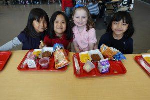 Little girls eating lunch